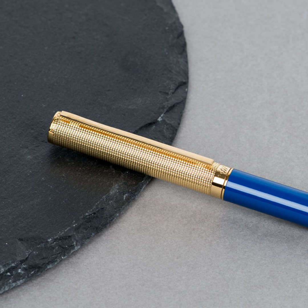 شماغ إيفنتو أحمرمميز قلم  نيتو ماراني أزرق براس ذهبي منقوش